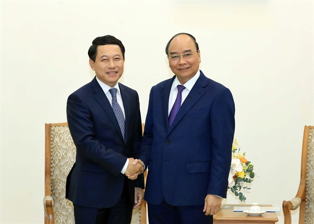 Lao FM commits support to Việt Nam