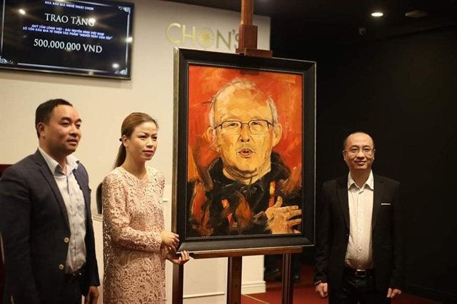 Portrait of coach Park fetches 12000 for charity