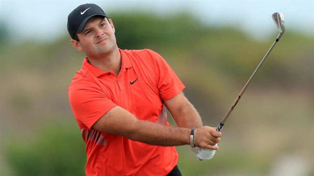 Reed moves clear as Woods surges in Bahamas