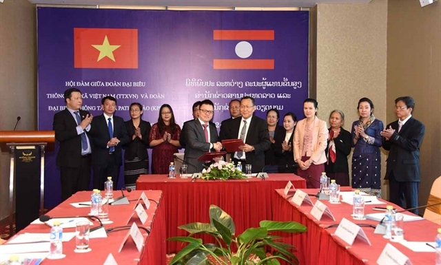 Vietnamese Lao news agencies forge cooperation to raise information quality