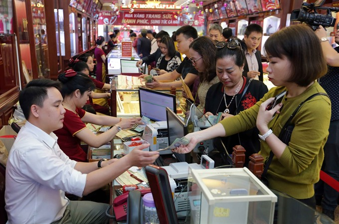 Gold selling prices rise varies from store to store on God of Wealth day