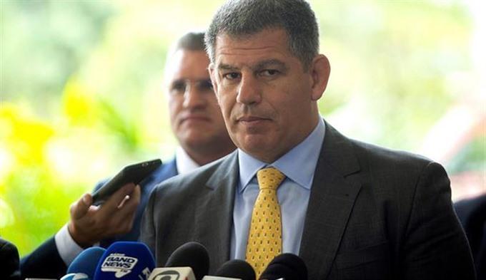 Brazil president sacks close aide amid political scandal