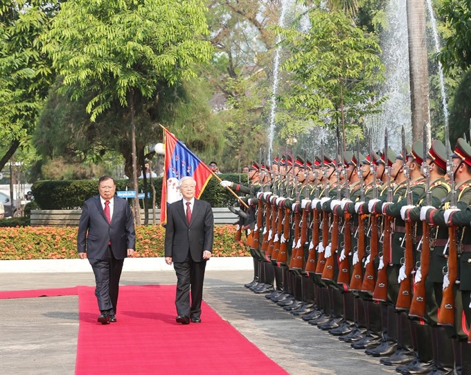 Top leaders of Việt Nam and Laos hold talks