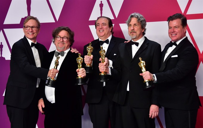 Cuaron wins three Oscars for Roma but Green Book is best film