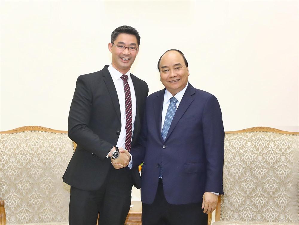 PM Nguyễn Xuân Phúc meets former German politician Philipp Rosler