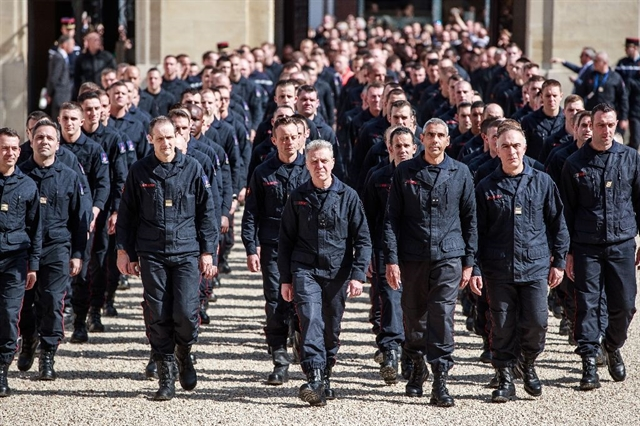 France salutes exemplary firefighters for saving Notre-Dame