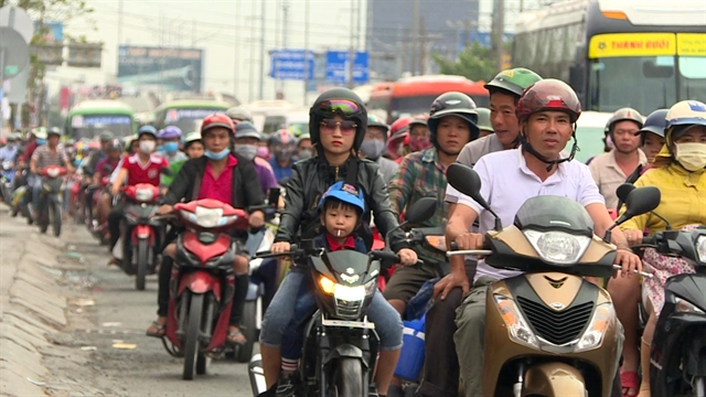 Heavy holiday traffic blocks highways into Hà Nội HCM City