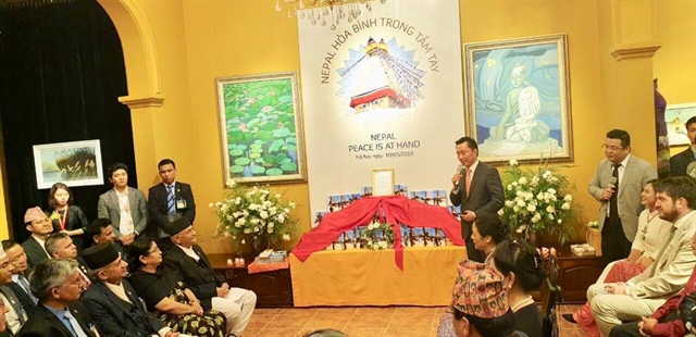 Nepal PM releases book on peace and Buddhism during Hà Nội visit
