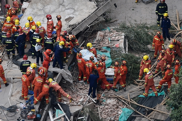 Toll in deadly Shanghai building collapse rises to 10