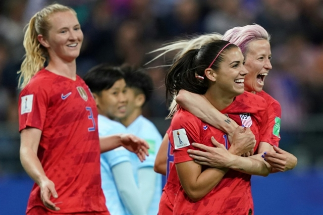 Morgan scores five as USA open World Cup defence with record victory