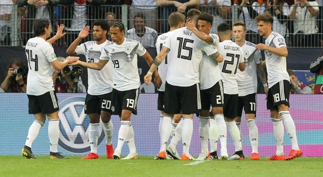 Realist Reus stays calm after Germany crush Estonia