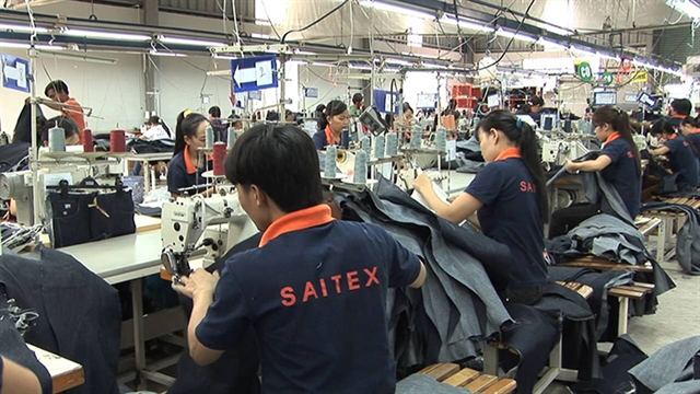 High-level Swiss delegation visits garment factory in Đồng Nai