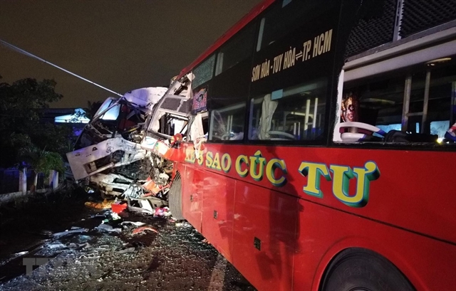 Collision between coach and truck kills two