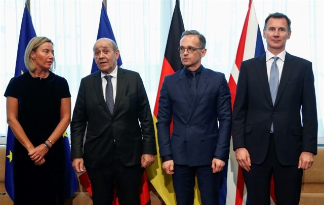 EU France Germany and UK urge Iran to reverse uranium decision