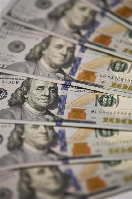 US Fed cuts key interest rate to insure against global uncertainties