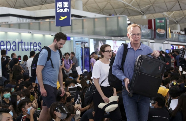 Flights resume at Hong Kong airport after protest shutdown