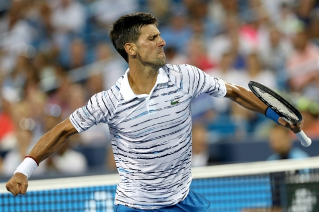 Djokovic motors into Cincy quarters as Federer ousted