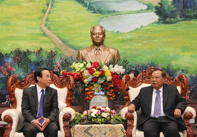 Top Lao leader receives officials of Party Central Committees Office