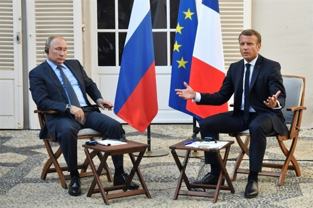 Macron Putin see chance on Ukraine but clash on Syria