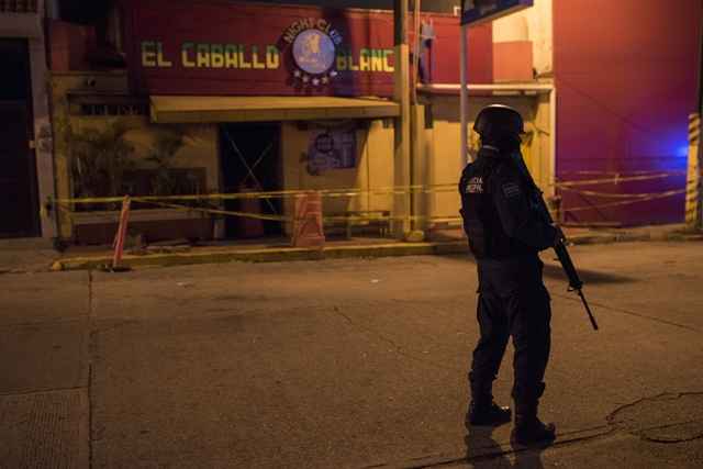 Toll rises to 28 in Mexico bar fire attack