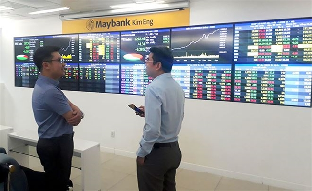 Shares slide money flows into industrial sector