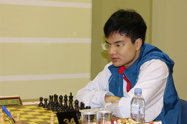 Liêm advances in World Cup Khôi becomes Grandmaster