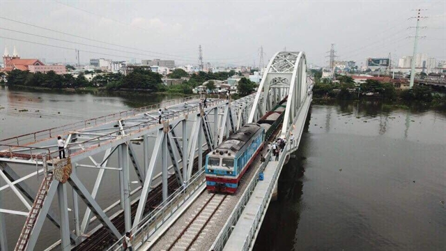 New bridge in HCM City crossing Sài Gòn River opens to train traffic
