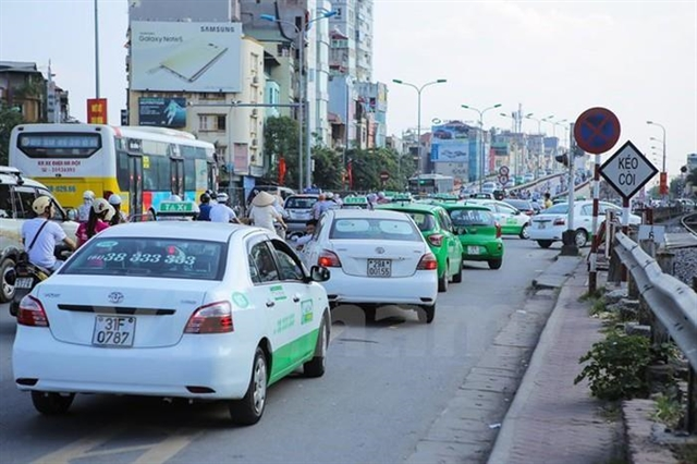 Hà Nội stipulates colours for taxis by 2026
