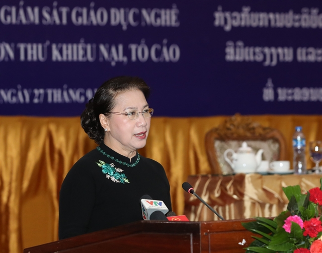 Legislatures of VN Laos share experience at joint workshop