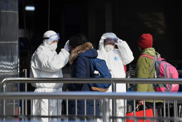 Gloomy holiday for hunkered-down China as virus toll jumps
