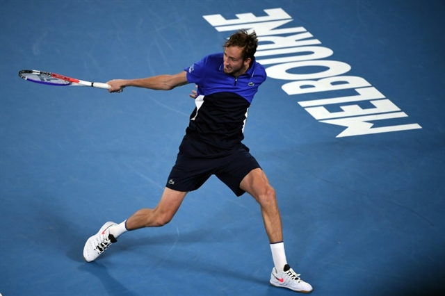 Medvedev cruises to set up Wawrinka last-16 clash