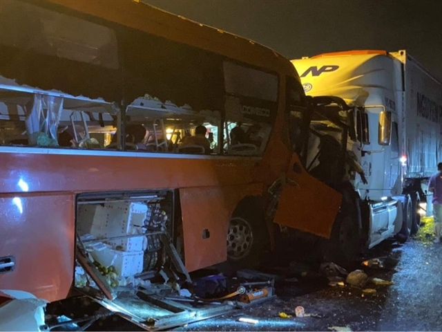 Two killed and 20 wounded after truck collides with coach