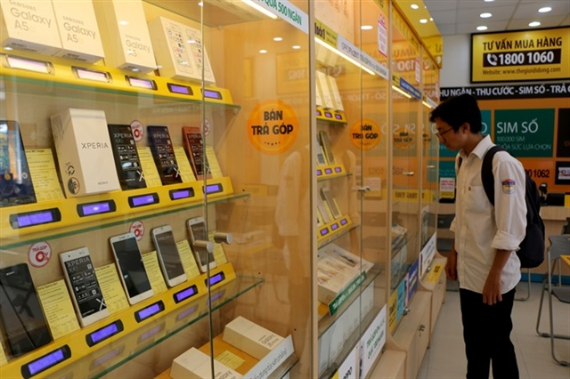 Mobile phone retailers shift to other services as market saturated