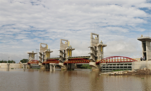 Sluice opened to regulate floodwater in Mekong Delta