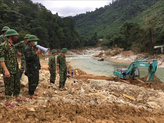 Rescue force discovers bodies of two workers central region braces for typhoon