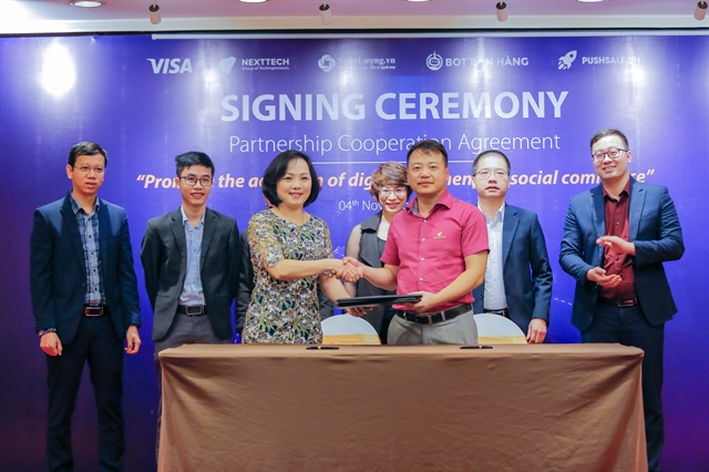 Visa and NextTech Group sign three-year partnership to support social commerce merchants in Việt Nam