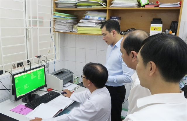 Health stations in wards communes use software for patient records