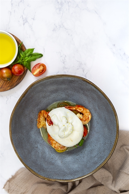 Burrata with prawns and warm marinated tomato salad