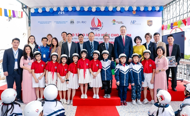 Quality helmets donated to special needs school in Hà Nội