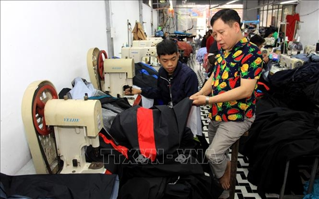 Handicapped businessman employs trainspeople with disabilities
