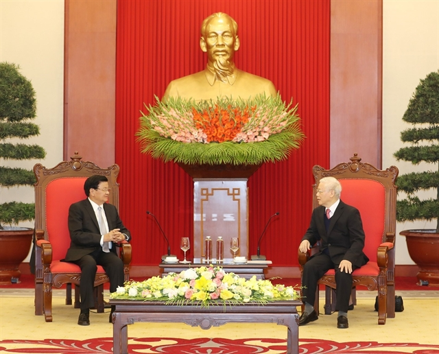 Party State leader Trọng meets visiting Laos PM