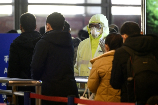 China stutters back to work as virus deaths soar