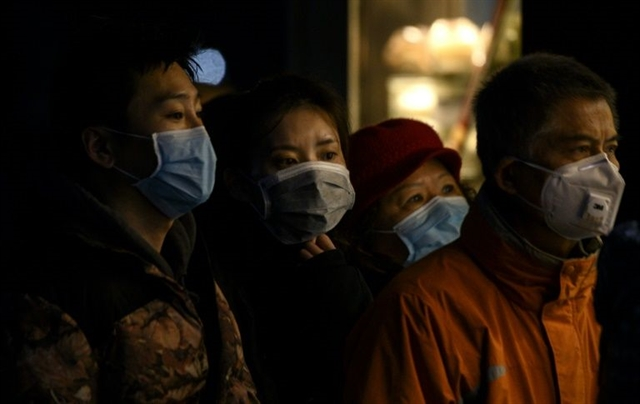 Death toll in China epidemic surges past 1500