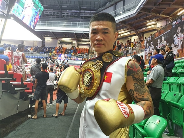 Hoàng knocks out Wongda to retain WBA Asia title