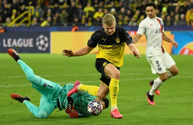 Haaland double gives Dortmund edge over PSG but Neymar strike keeps tie alive