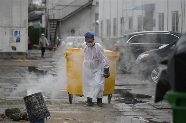 Virus death toll tops 2000 in China Hong Kong sees 2nd fatality