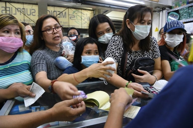 Philippines reports first virus death outside China