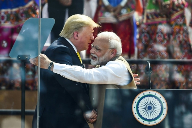 Down to business for Trump in India