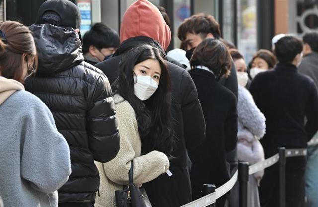 South Korea virus cases surge as WHO sounds maximum alert