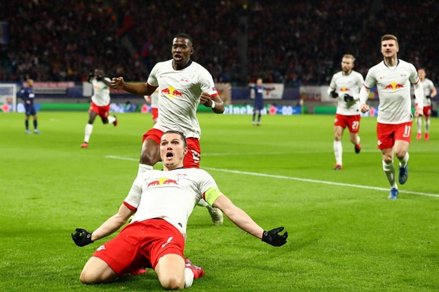 Leipzig cruise past Spurs into Champions League quarters